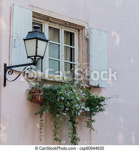 Vintage lamp on attached to the wall of the building - csp60944635