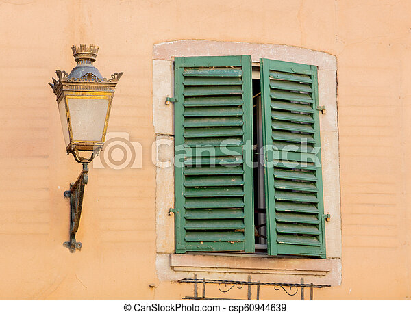Vintage lamp on attached to the wall of the building - csp60944639