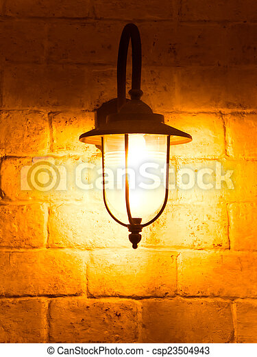 vintage lamp on old wall - csp23504943