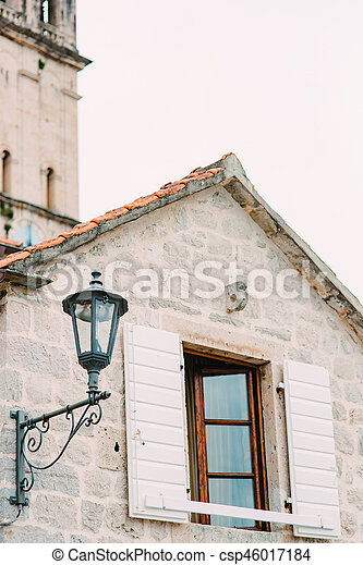 Vintage lamp on the wall on street - csp46017184
