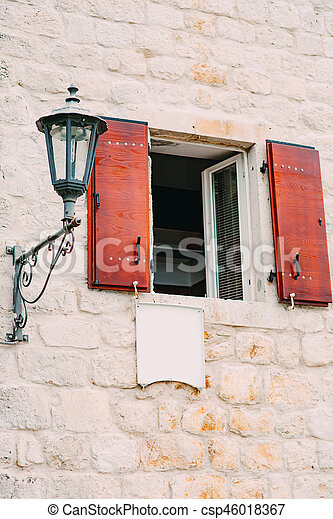 Vintage lamp on the wall on street - csp46018367