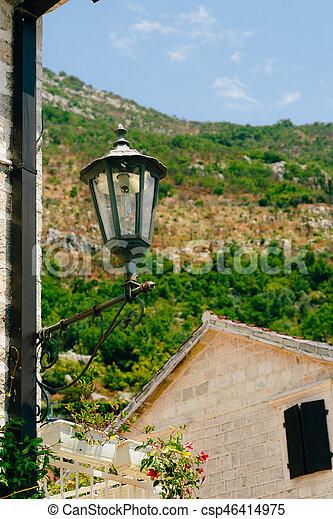 Vintage lamp on wall on street - csp46414975