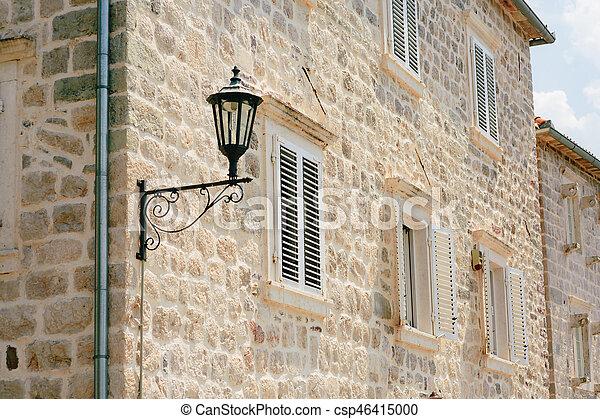 Vintage lamp on wall on street - csp46415000