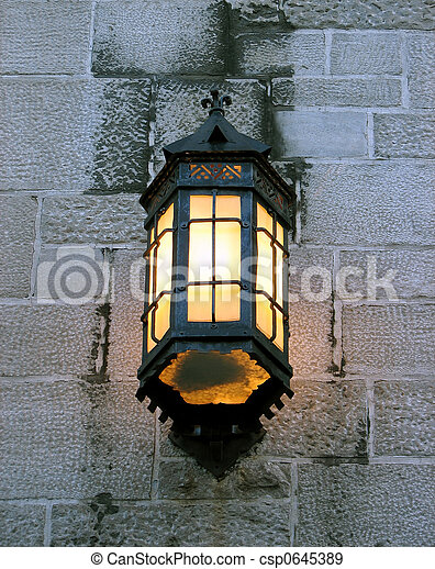 Vintage lantern on a stone wall of an old building - csp0645389