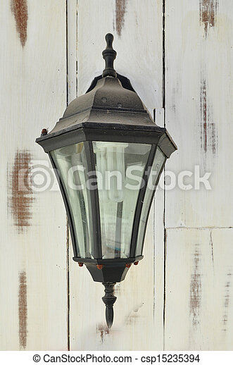 Vintage lantern on a wall - csp15235394