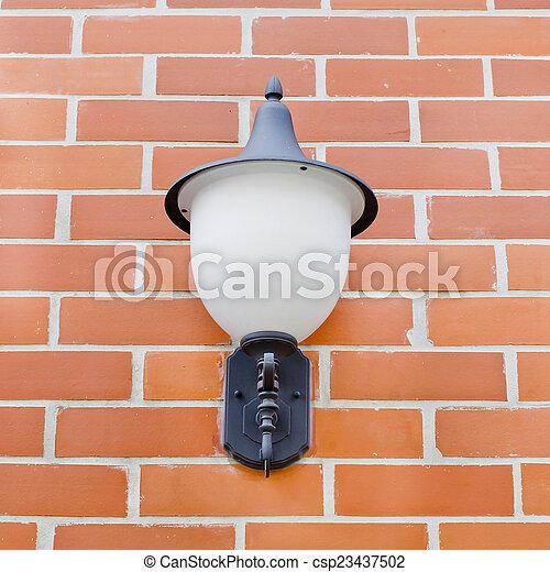 Vintage lantern on a wall. - csp23437502