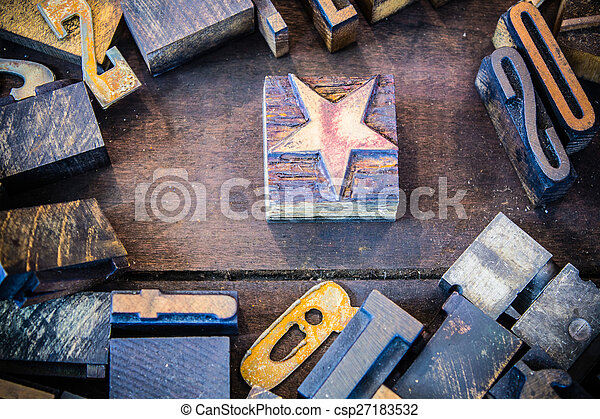 Vintage Letterpress Star with Numbers and Letters - csp27183532