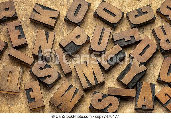 vintage letterpress wood type printing blocks - csp77476477
