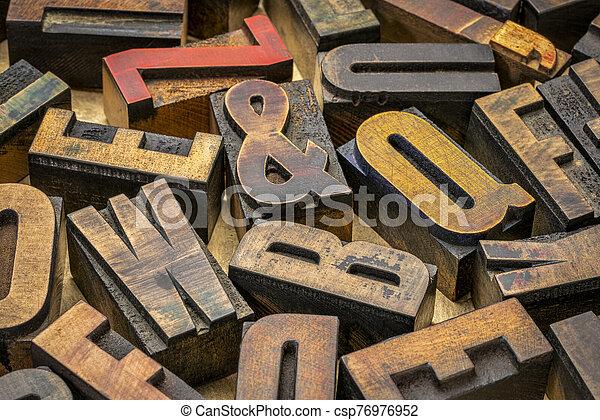 vintage letterpress wood type printing blocks - csp76976952