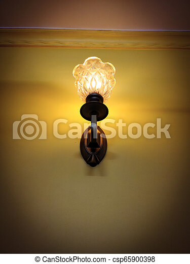 Vintage old bedroom lamp on wall - csp65900398
