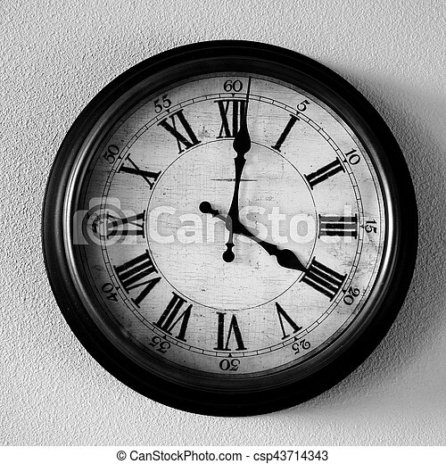 Vintage old clock hanging on wall for time csp43714343