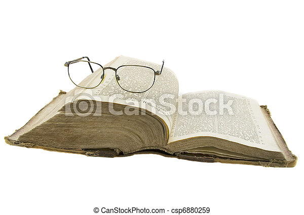Vintage open book bible open and glasses on it isolated over white - csp6880259
