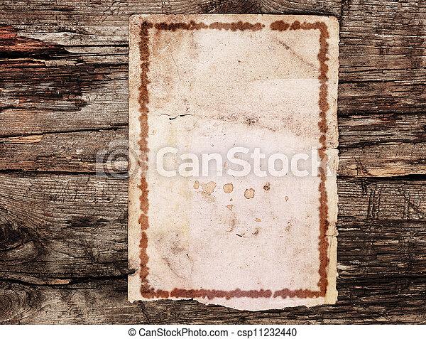 vintage paper on old wood texture - csp11232440