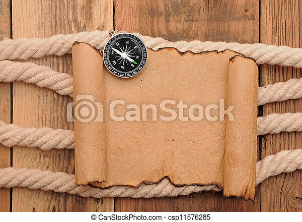 Vintage paper scroll with compass and rope on old wooden boards - csp11576285