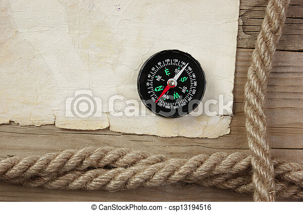 Vintage paper with compass and rope on old wooden boards - csp13194516