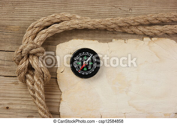 Vintage paper with compass and rope on old wooden boards - csp12584858