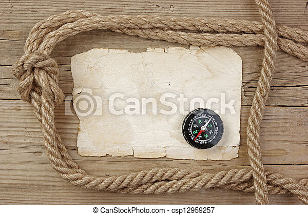 Vintage paper with compass and rope on old wooden boards - csp12959257