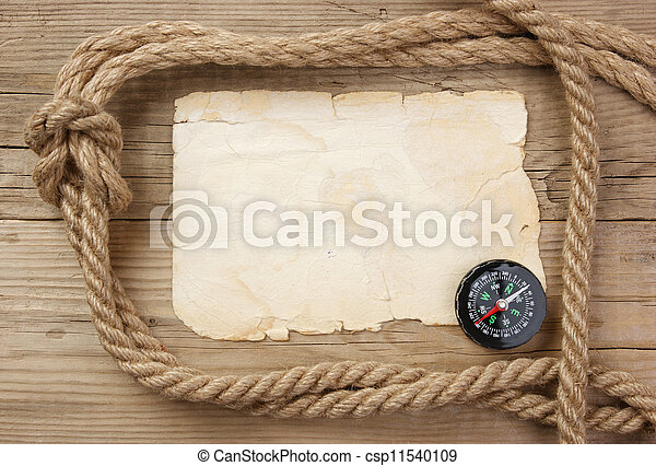 Vintage paper with compass and rope on old wooden boards - csp11540109