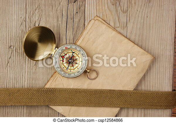 Vintage paper with compass  on old wooden boards - csp12584866
