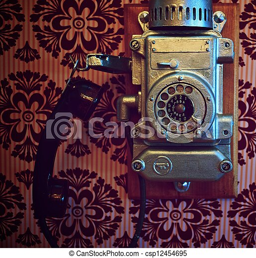 Vintage phone on a wall. - csp12454695