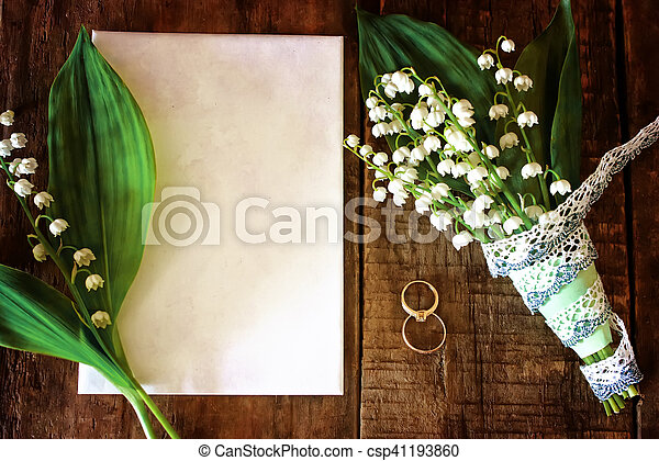 Vintage photo Wedding bouquet of lilies of the valley and ring - csp41193860