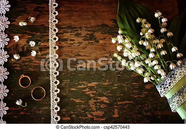 Vintage photo Wedding bouquet of lilies of the valley and ring - csp42570443
