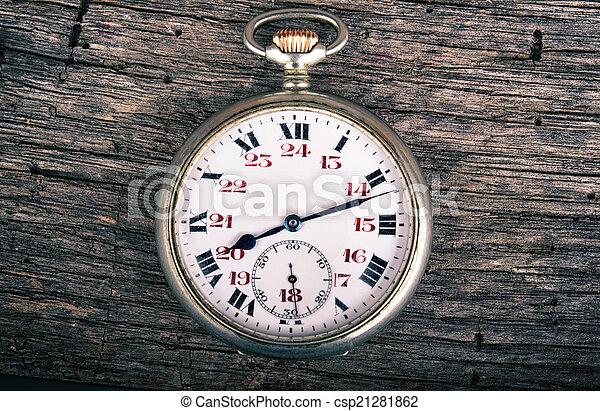 vintage pocked watch on old wood - csp21281862