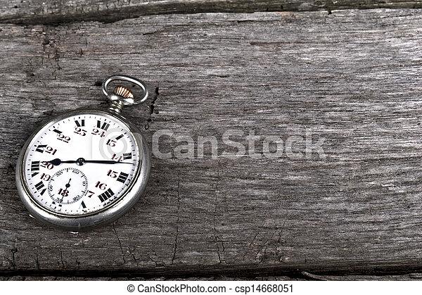 vintage pocked watch on old wood - csp14668051