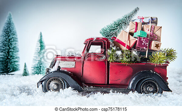 Vintage red truck delivering Christmas gifts - csp75178115