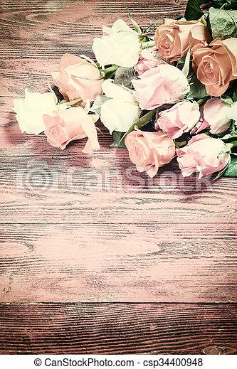 Vintage Rose Flowers On Rustic Backdrop