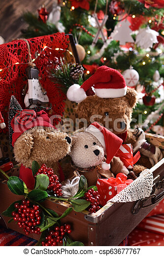 Vintage Style Christmas Ornaments.Vintage Style Teddy Bears Sitting In Old Suitcase In Front Of Christmas Tree