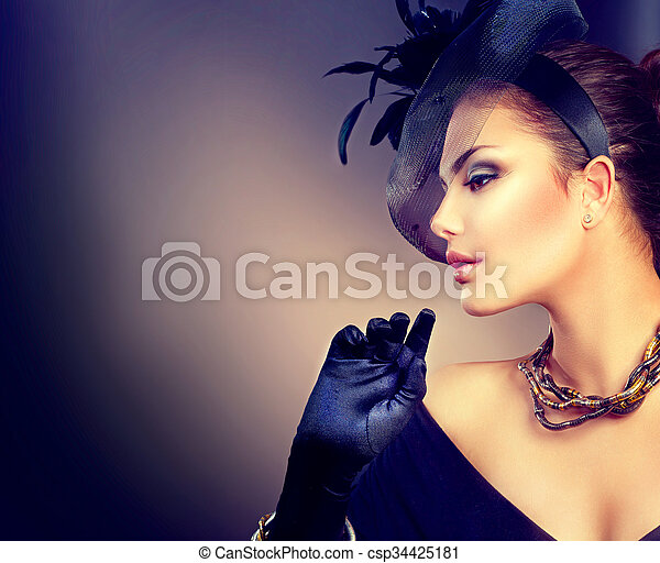 Vintage style woman wearing hat and gloves. Retro woman portrait - csp34425181
