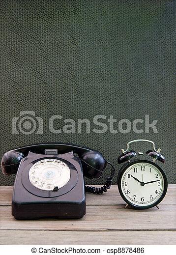 Vintage telephone, clock - csp8878486