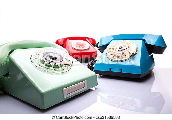 Vintage telephones on white - csp31589583