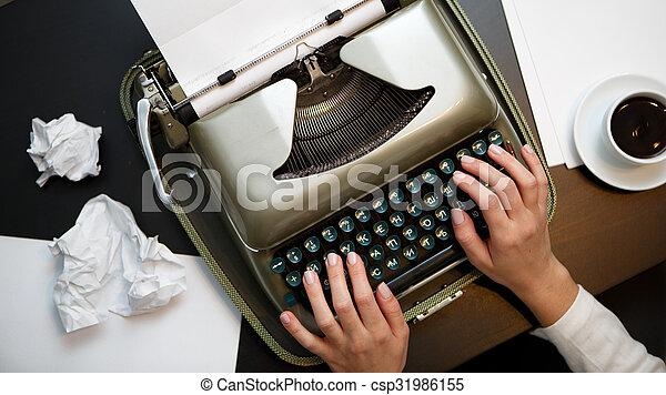 Vintage typewriter and white paper - csp31986155