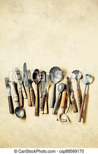 Vintage utensils, spoons, forks and knifes - csp88569170