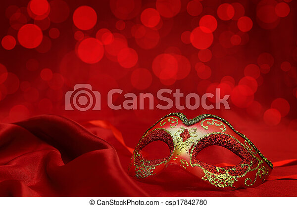 Vintage venetian carnival mask on red background - csp17842780