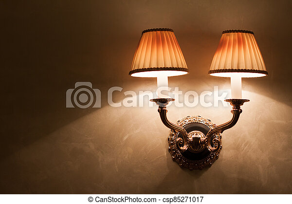 Vintage wall lamp on old textured wall - csp85271017