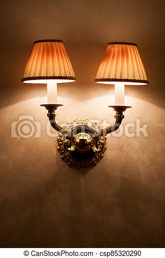 Vintage wall lamp on old textured wall - csp85320290