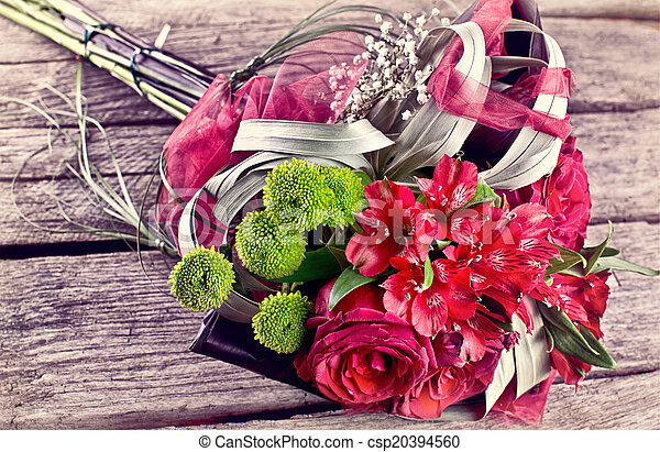 vintage wedding bouquet on old wood - csp20394560