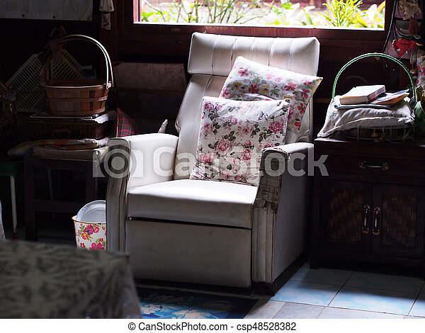 Vintage White Old Sofa Near Window In Messy Living Room