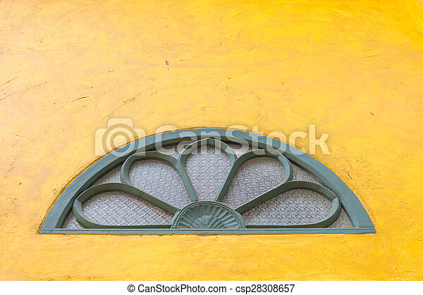 Vintage windows on abstract yellow cement wall texture background - csp28308657
