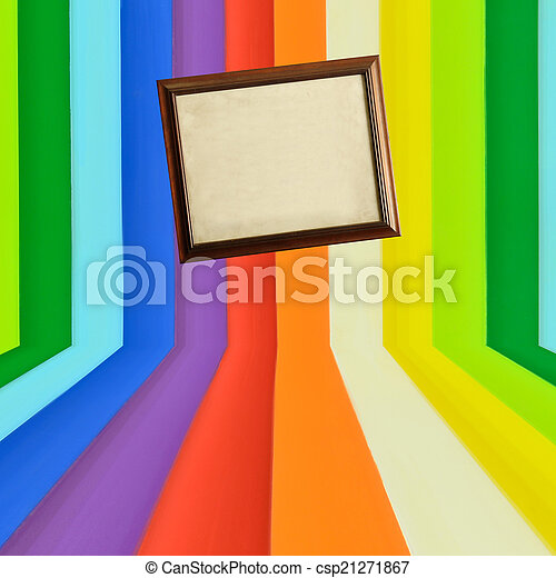 Vintage wooden picture frame on creative colorful wall - csp21271867