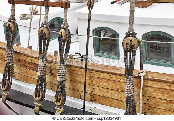 Vintage wooden pulley block in an ancient boat - csp12034981