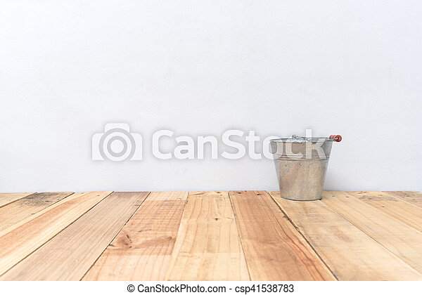 Vintage zinc bucket on wooden table and cement wall background - csp41538783