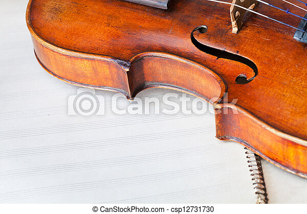 violin bout with f-hole on music book - csp12731730