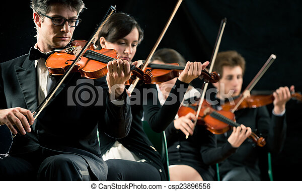 Violin orchestra performing - csp23896556