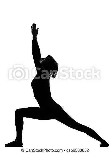 virabhadrasana 1 warrior postion yoga woman - csp6580652