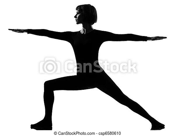virabhadrasana 2 warrior postion yoga woman - csp6580610