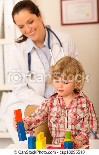 Visit at pediatrician child girl playing - csp18235510